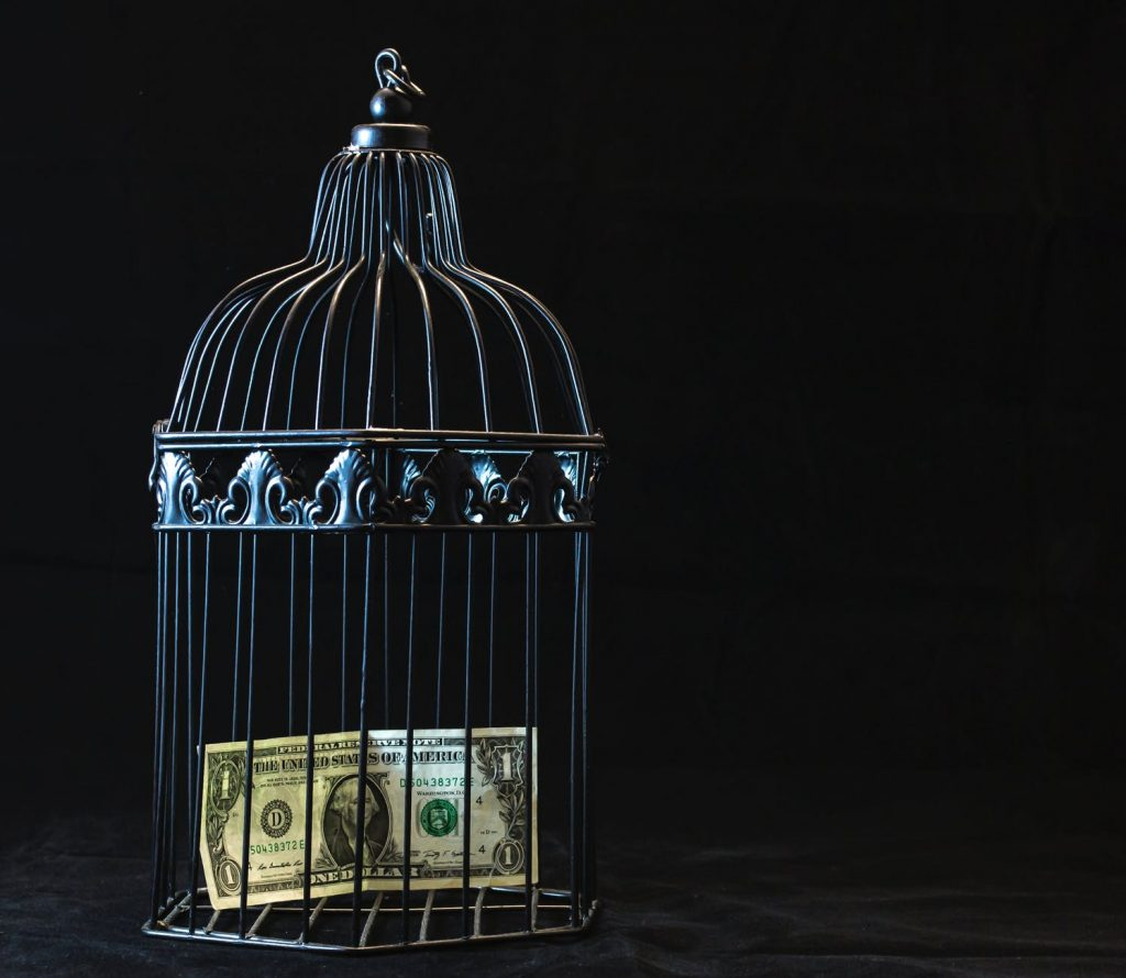 review with nash money inside a cage